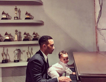 John Legend shares Photo of himself Playing the Piano with his Daughter Luna